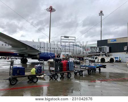ZURICH - MARCH 13, 2018: Baggage being loaded from trolleys onto an Aeroflot Boeing 737 passenger jet on stand at Zurich Kloten International Airport in Zurich, Switzerland.
