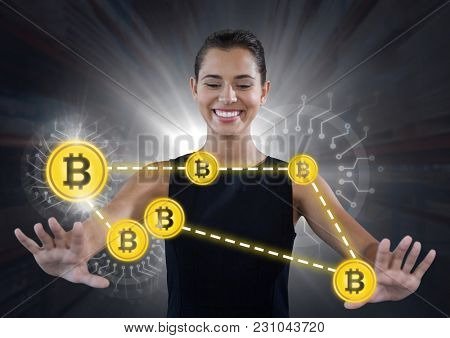 Digital composite of Businesswoman touching bit coin graphic icons