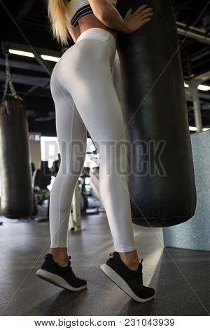 Legs Of A Sexy Girl In White Leggings In The Gym. Mock-up.