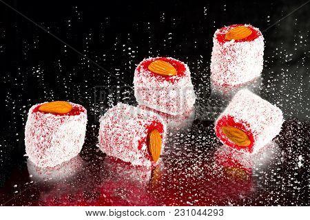 Rakhat-lukum Sprinkled With Coconut Shavings And Almond On Dark Background, Turkish Sweets