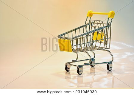 Close The Grocery Store In The Supermarket And Push The Shopping Cart With The Yellow Handle Isolate
