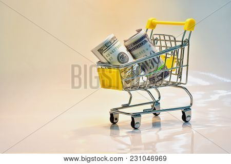Close The Supermarket Grocery Store, Push The Shopping Cart With Yellow Handle With Dollar Banknotes