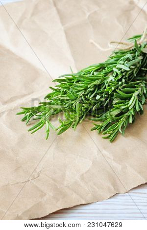 Bunch Of Rosemary On Wrapping Paper. Copy Space Composition. Selective Focus