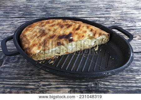 Homemade Cake With Cottage Cheese And Parmesan Cheese, Which Melted In A Hot Oven. Pie On A Cast Iro
