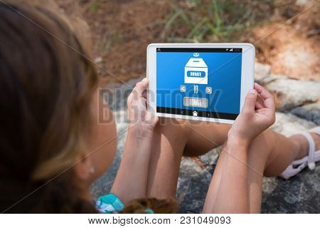 Vector icon of donation against girl holding digital tablet in the forest