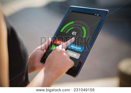 Mobile display with memory cleaner against businesswoman using digital tablet