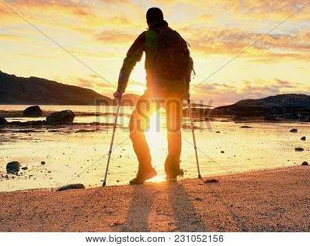 Disabled Hurt Hiker Man Is  Celebrate Alone Attachment Of His Target. Tourist  Stand Or Walk Along S