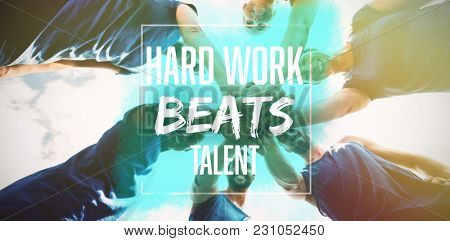 Hard work beats talent against fit people with hands stacked