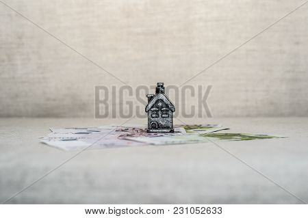 The House Stands On Banknotes, The Concept Of Money Savings, Loans
