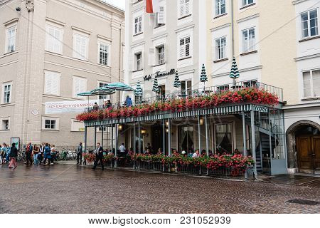 Salzburg, Austria - August 6, 2017: Alter Markt. Scenic Cityscape Of Cafe In Historic City Centre Of