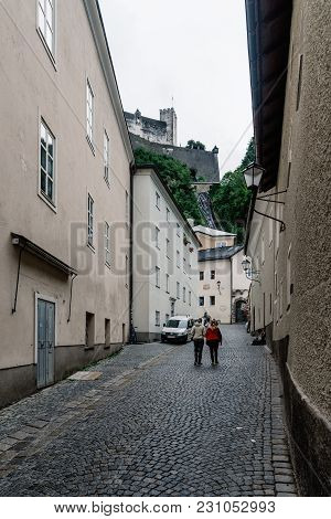 Salzburg, Austria - August 6, 2017: Street In Historic City Centre Of Salzburg A Rainy Day