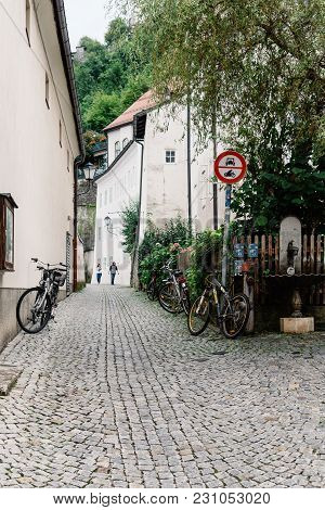 Salzburg, Austria - August 6, 2017: Picturesque Street In Historic City Centre Of Salzburg A Rainy D