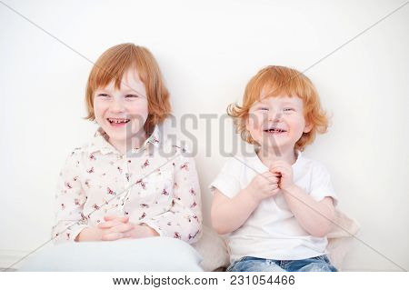 Laughing Funny Redhead Brother And Sister On The White Background