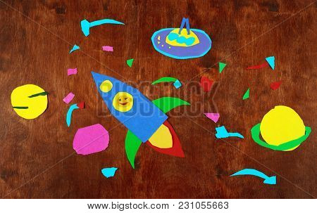 space rocket and planets, solar system, Astronautics and space alien on wooden background-application made by child