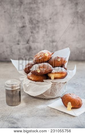 Doughnuts With Creamy Lemon Filling Dusted With Icing Sugar, Copy Space For Your Text