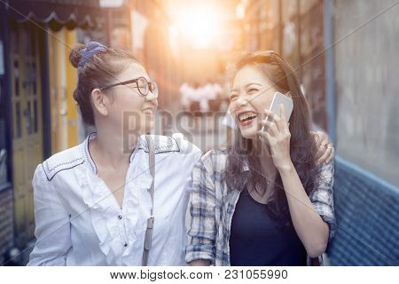 Close Up Face Of Two Asian Woman Laughing With Happiness Emotion In Shopping Street