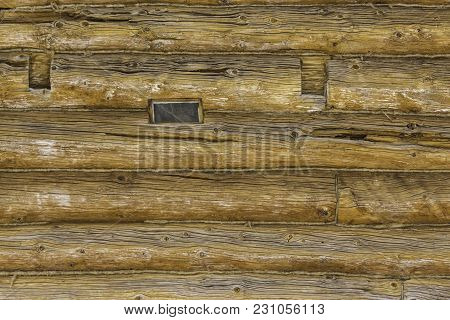 Wooden Restored Barn. Built In The 18th Century. A Log Wall. Interesting Photo For The Site About Co