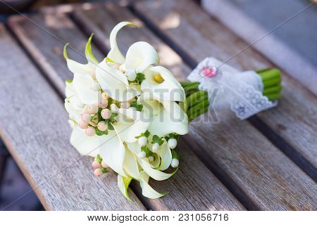 Beautiful Wedding Bouquet Of White Callas On The Bench