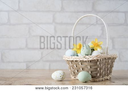 Easter Background With Small Basket Put On Brown Wood Side View And Full With Easter Eggs In Soft Co