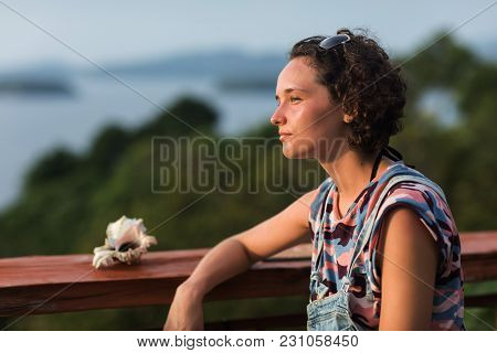 Unplugged Curly Haired Woman Outdoors