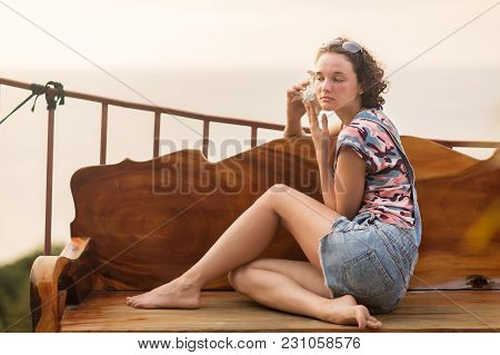 Young Slim Woman Seashell In Hands