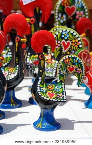 Painted Rooster Ornaments Which Are The Unofficial Symbol Of Portugal, Algarve, Portugal, Europe.