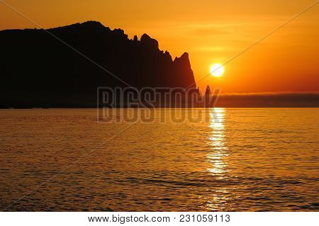 Sunrise Over Mountain And Sea Surface In Morning Fog. View Of The Mountain Range Karadag What Is An