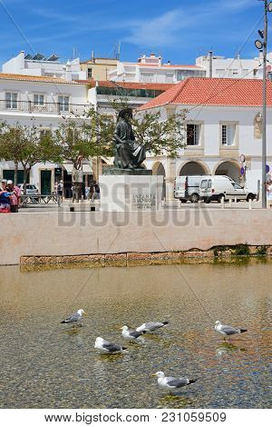 Lagos, Portugal - June 9, 2017 - Seagulls In A Pool In Infant Square With A Statue Of Infante Dom He