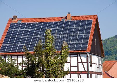 Solar panels on an old timbered house