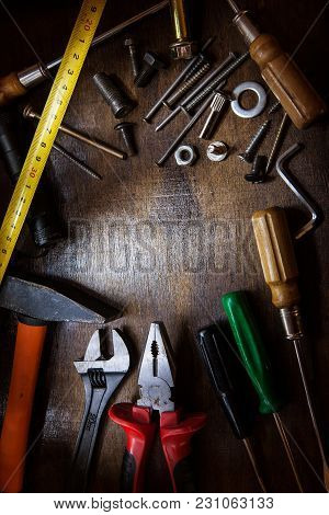 Worker Table With Instruments On Wooden Background