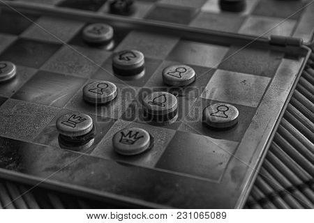 Monochrome Photo With A Picture Of A Chess Steel Board And Chess Pieces, Metal Chess Pieces On A Che