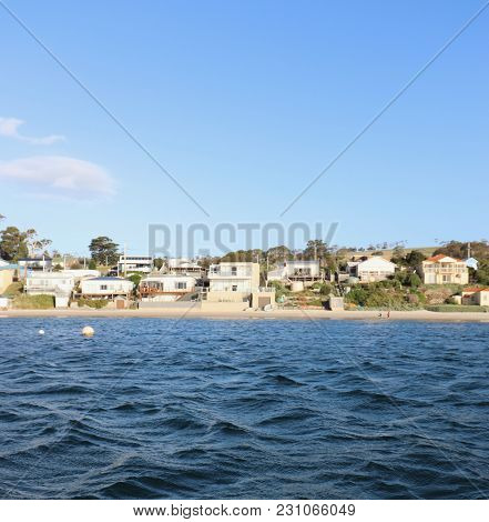 View Of Beachfront Shacks And Villas From Water, Waterfront Property On Coast, Houses Along Waterfro