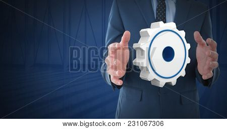 Digital composite of Cog settings icon symbol and Businessman with hands palm open and dark background