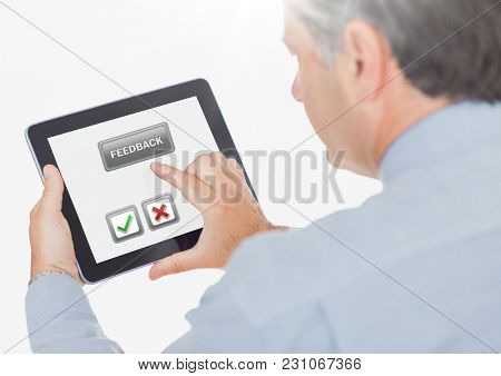 Digital composite of Hand holding tablet with feedback satisfaction buttons