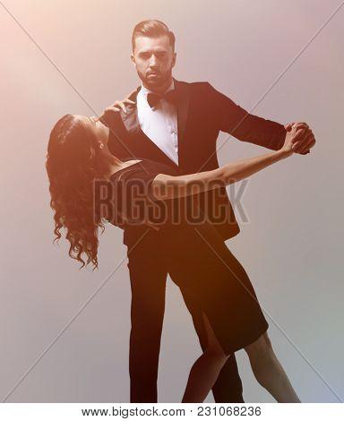 Attractive young couple dancing in studio.