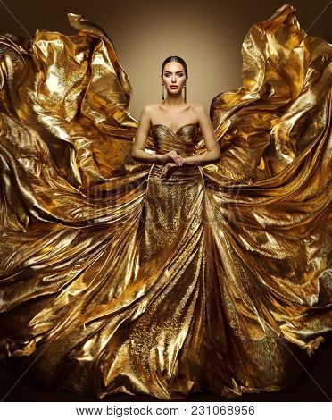 Gold Woman Flying Dress, Fashion Model In Waving Golden Gown, Fluttering Fabric Fly Like Wings, Art