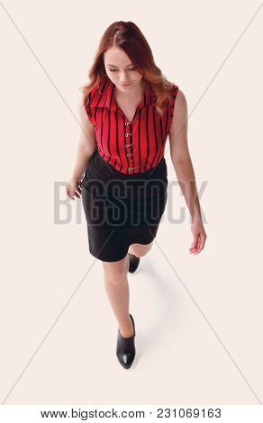 A beautiful woman in red attires takes a step