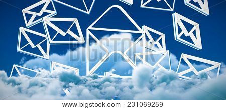 Multiple message symbols against low angle view of white clouds against sky