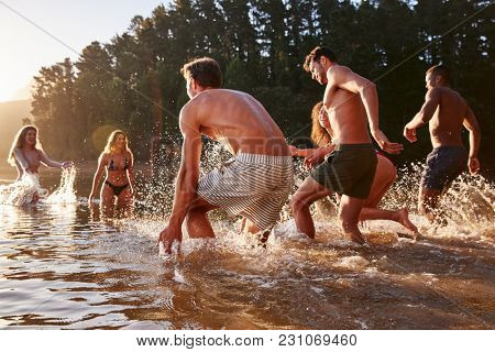 Young adult group on vacation having fun in a lake