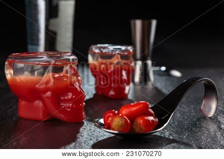 Preparing Shots Of Bloody Mary In A Glass In The Shape Of A Skull.