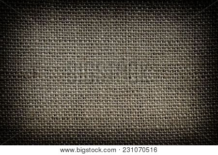 Cloth background. Vignette. Natural fabric. Grunge fabric background. Fabric texture. Fabric background. Grunge backdrop. Grunge style. Sacking. Natural style. Rough material.