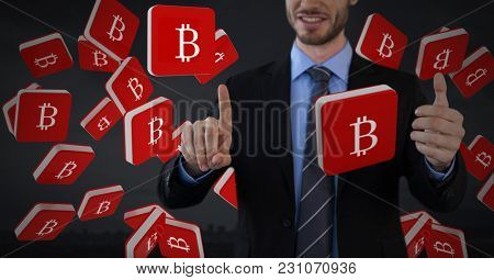 Digital composite of Bit coin icons and Businessman touching air with dark background