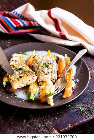 Plate Of Fried Tilapia Fish Fillet (two Pieces) With Baby Carrots In Cream Sauce With Peppercorns De