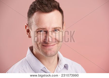Headshot Of Smling Young Man Isolated On Pink Background