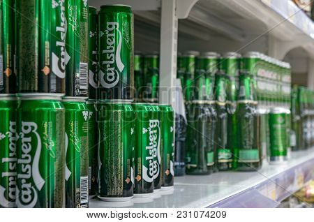 Moscow, Russia - March 12, 2018: Display with Carlsberg beer in cans in supermarket Lenta. One of largest retailer in Russia