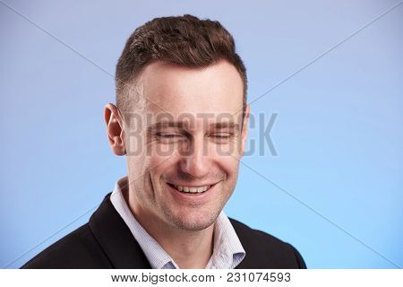 Man Laugh With Closed Eyes On Blue Background Close Up
