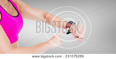 Female athlete using her smart watch against digital composite of heart icon