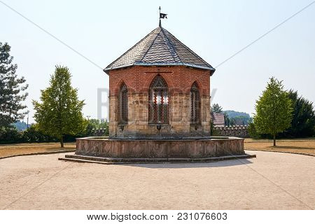 Czech Republic,sychrov - August 9, 2015: Fountain Near Neo Gothic Castle Sychrov. Castle (chateau) W