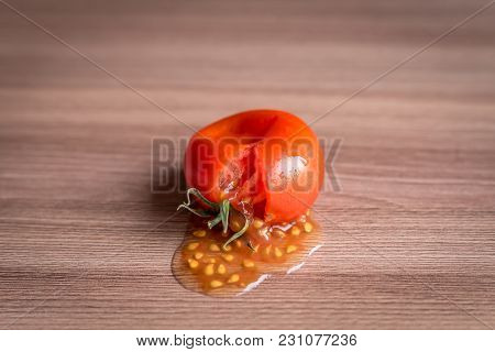 Smashed Cherry Tomato On Wooden Table, Background