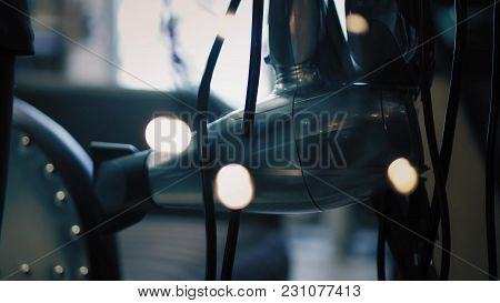 Closeup View On Hair Dryer Surrounded With Twinkle Lights In Beauty Salon. Soft Focus Change.